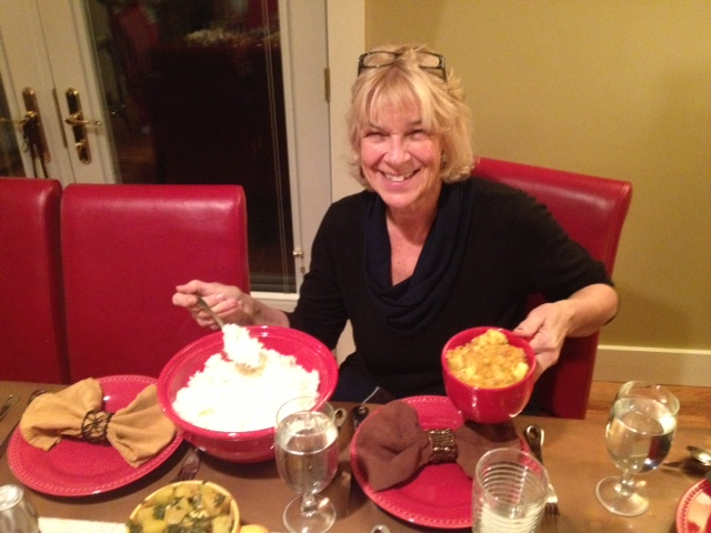 Cathy showing off her homemade Indian dinner