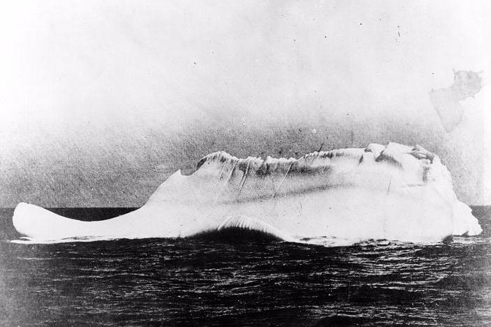MINIA  was one of the first ships to arrive at the scene of disaster, dispatched by White Star Lines to recover bodies and debris from the  Titanic . Captain de Carteret stated that this was the only iceberg near the site of the collision. This photo earns more debate than the others, most likely due its resemblance or lack thereof (some argue that the iceberg has at this time flipped over, explaining the height of the line). There may have been other icebergs in that area, but how many? And with a red streak of paint (visible near midline) to boot?