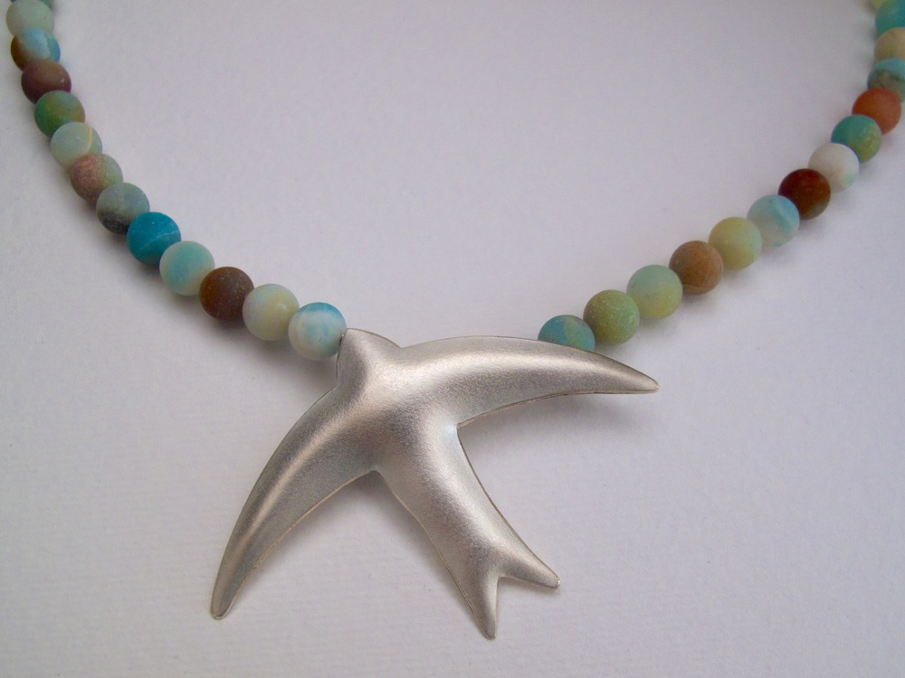 Sterling silver bird pendant on frosted amazonite beads