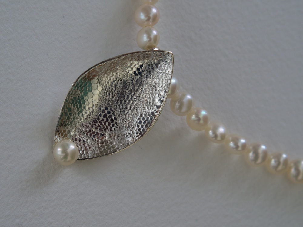 Lace textured sterling silver leaf pendant with white freshwater pearls