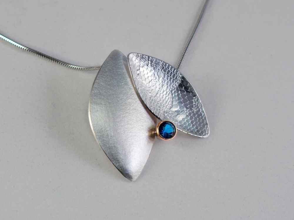 Silver leaf duo pendant with London Blue topaz set in 9 carat gold