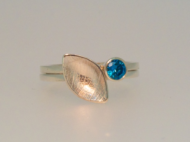 Falling leaves stacking rings with vibrant blue cubic zirconia