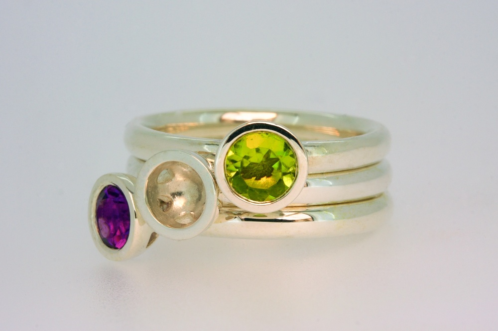 Scattered trillion stacking rings with peridot and amethyst