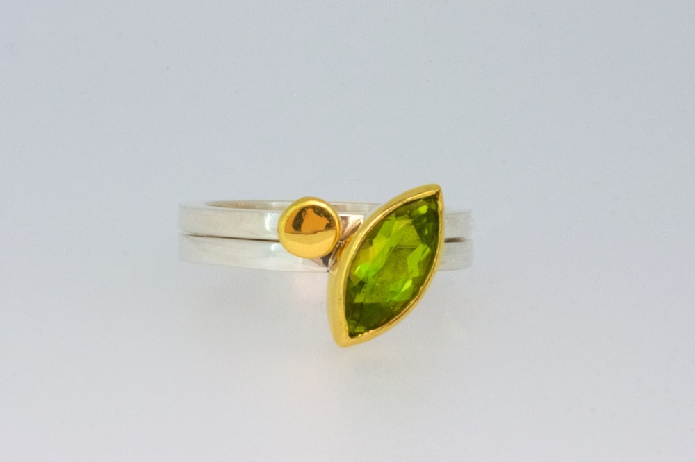 Gold nugget stacking rings with marquise peridot