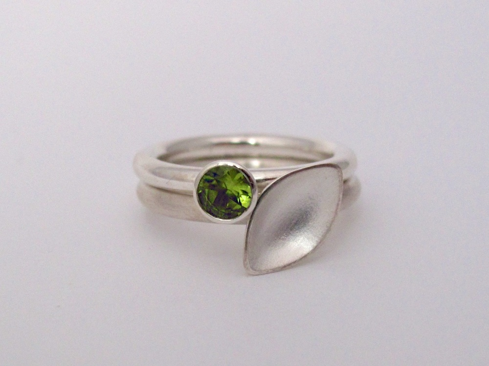 Falling leaves stacking rings with peridot
