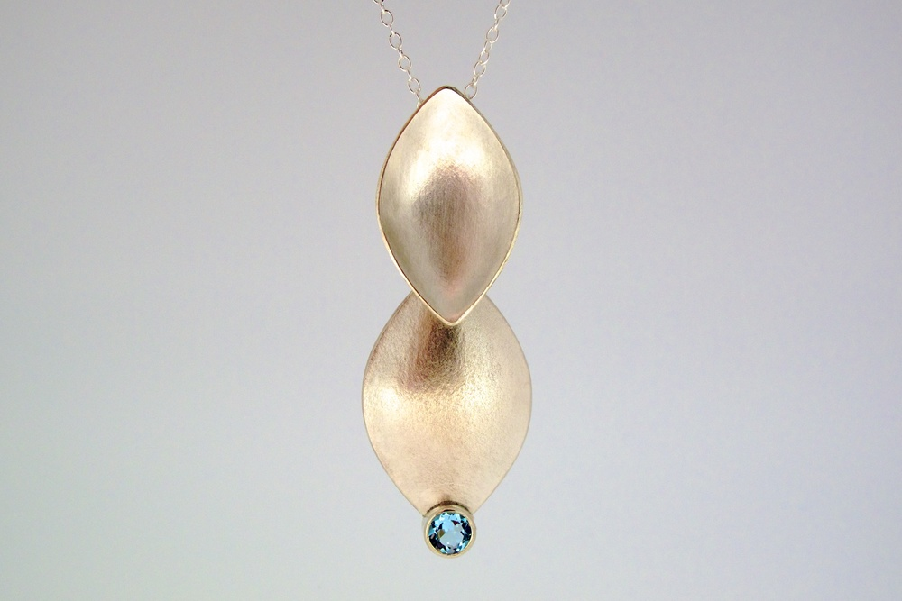 Sterling silver falling leaves pendant set with sky blue topaz