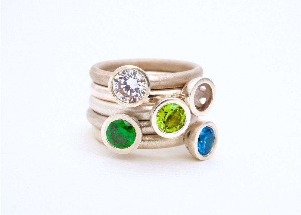 Scattered trillions stacking rings in cool tones