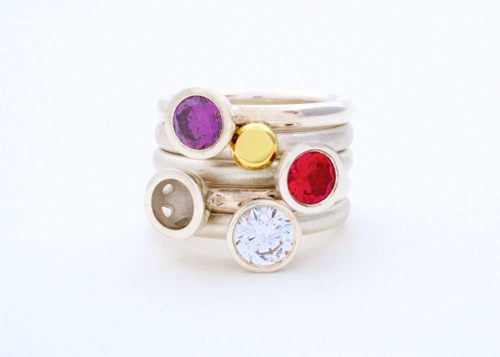 Scattered trillions stacking rings in warm tones