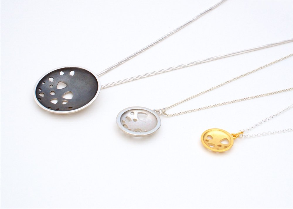 Scattered trillions necklaces in three sizes and finishes