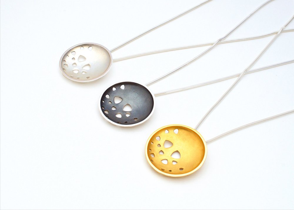 Kate Phipps Large scattered trillions pendants in three different finishes.jpg