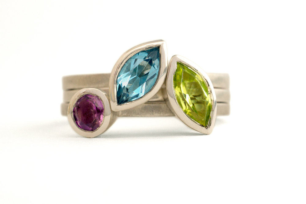 Marquise and round stone ring trio