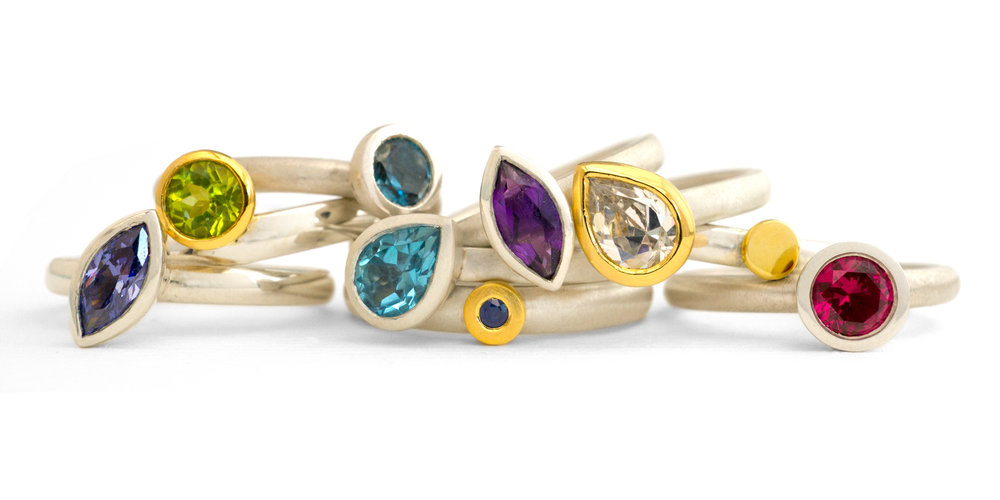 Silver, 18 carat gold and gemstone stacking rings