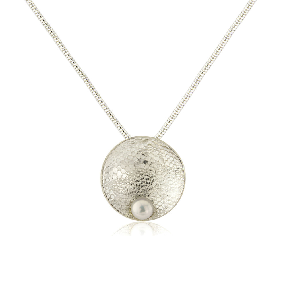 Domed lace embossed silver circle and freshwater pearl necklace