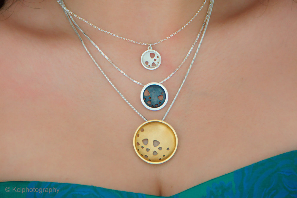 Three scattered trillions necklaces in three finishes