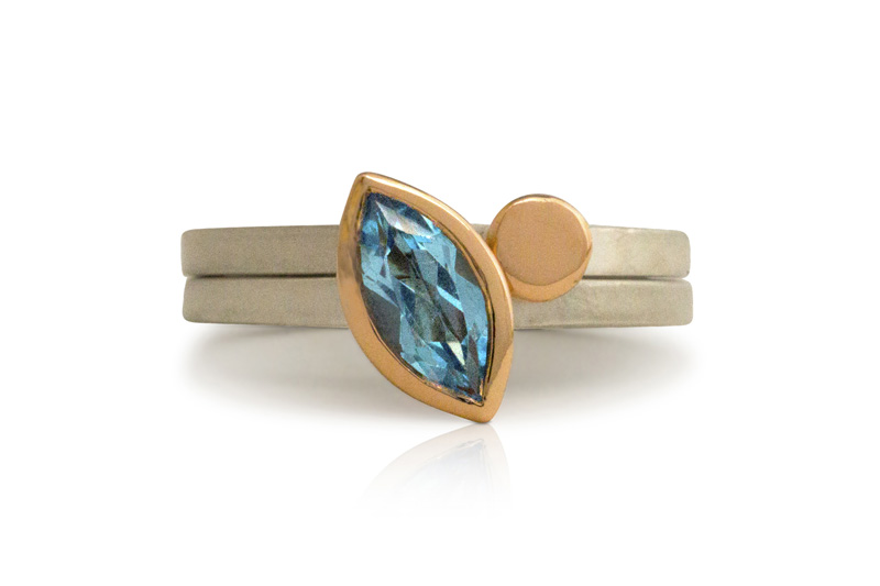 Swiss blue topaz, 9 carat rose gold and silver stacking rings