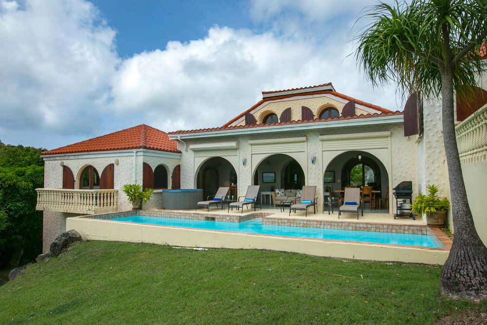 The house's living area spills out to the pool with the amazing views of the Virgin Islands National Park, The Caribbean Sea and the British Virgin Islands beyond.