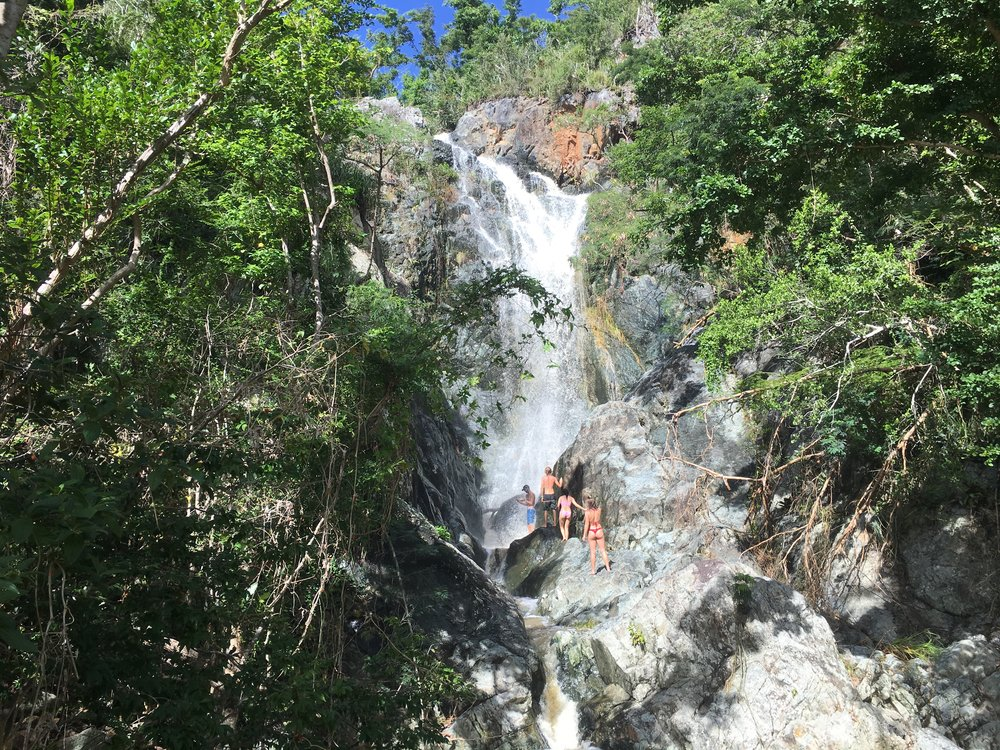 Hiking to waterfalls in lush tropical forests under blue skies is just one of the ways to spend your day this winter on St John