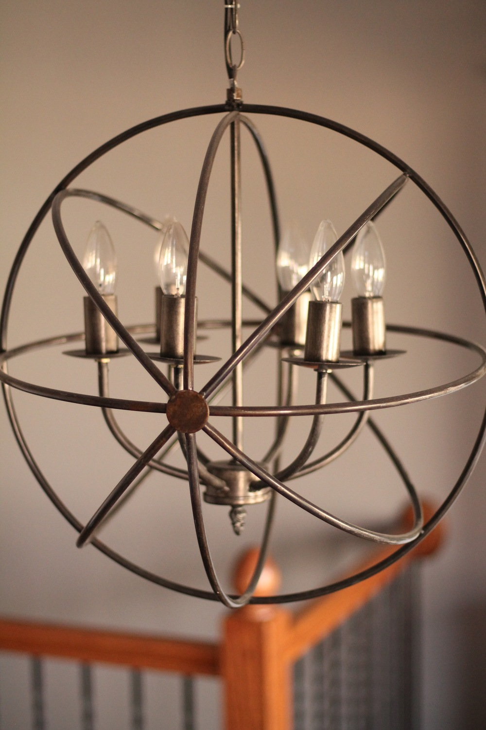 You can find globe chandeliers like this one and many others at RE:.    Photo from: Anna Huff