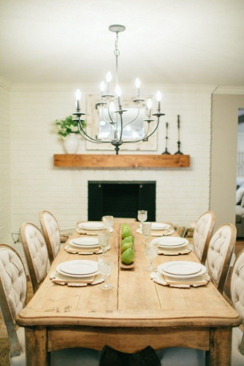 The Magnolia look: this is a great long farm table and Joanna paired with some elegant plush chairs.  Photo from: Magnolia Market