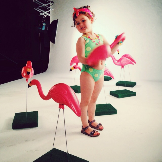 How cute is Miss. Claire in this fabulous chartreuse polka dot swimsuit and her sea of flamingos! I went for a very rockabilly vibe with this one.