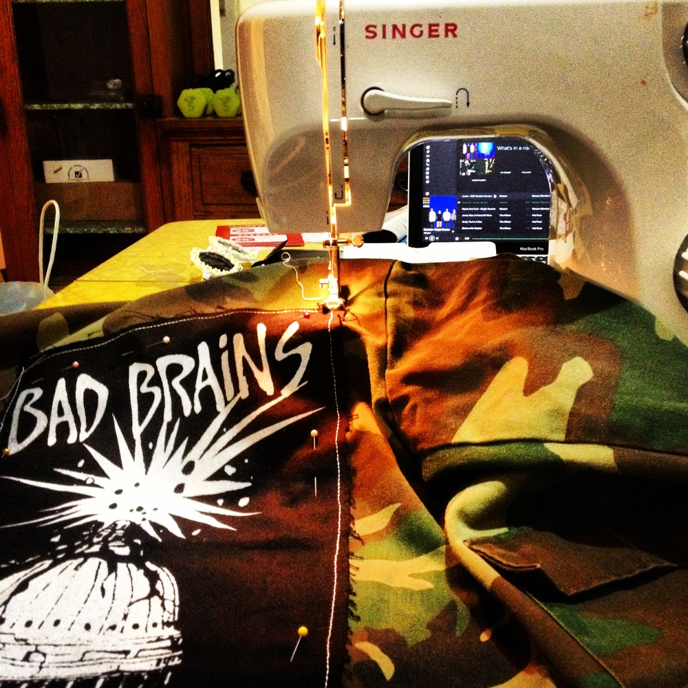 oh, you know, just sewing a killer back patch of only THE BEST BAND EVER on a thrifted vintage camo kiddie jacket to use at the shoot. NO BIG DEAL!