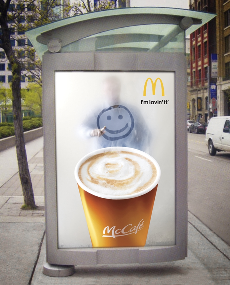 Bus Shelter sign introducing McCafe specialty coffees. Photo was shot in studio with model drawing on steamed glass.