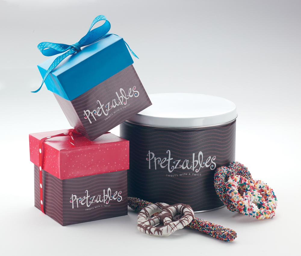 Logo and packaging for line of gourmet chocolate covered pretzels.