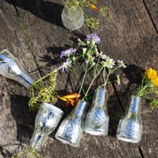 Small bud vases with an antique silver finish made in India by Nkuku