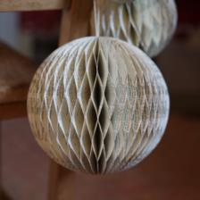 Recycled hand made paper decorations with lines from Shakespeare plays are made in India by Nkuku