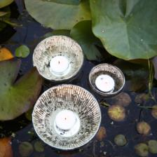 These pretty Jasmine t-light holders float beautifully on water, made in India by Nkuku