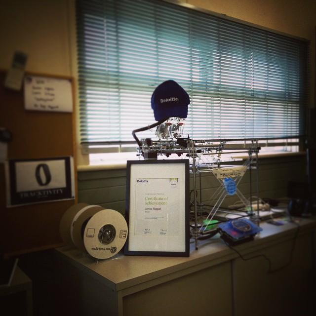Our 3D printer looking mighty dapper in its fancy new Deloitte cap.