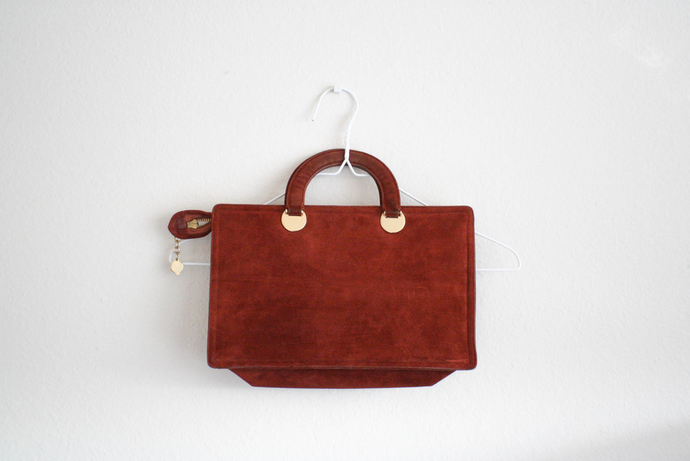 I also got this real cute vintage hand bag by Jay Herbert- New York. It's 100% suede and in a great color too! And in excellent condition I might add. $12.00