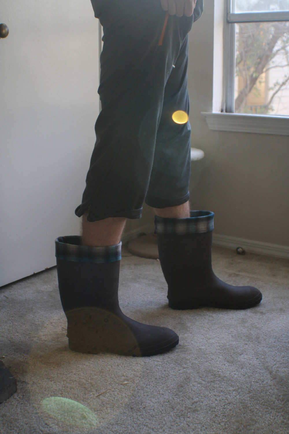 ....I asked him to pose in them. This is how he did it. Ha! I hope you enjoyed this tutorial. I will certainly be making myself a cute pair for my rain boots soon!!!