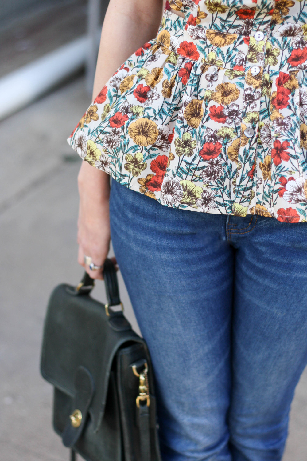 Peplum floral blouse: Forever 21 Jeans: Urban Outfitters Purse: Vintage Coach Buckle flats: Melissa Vivienne Westwood Necklace: Thrfited (Buffalo Exchange) Photographs by Morgan Williams