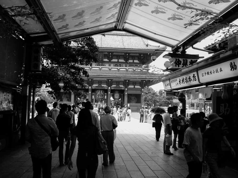 Exit of one of two long indoor lines of souvenir shops at Sensō-ji in Asakusa, Tokyo, popular with tourists both domestic and from abroad.