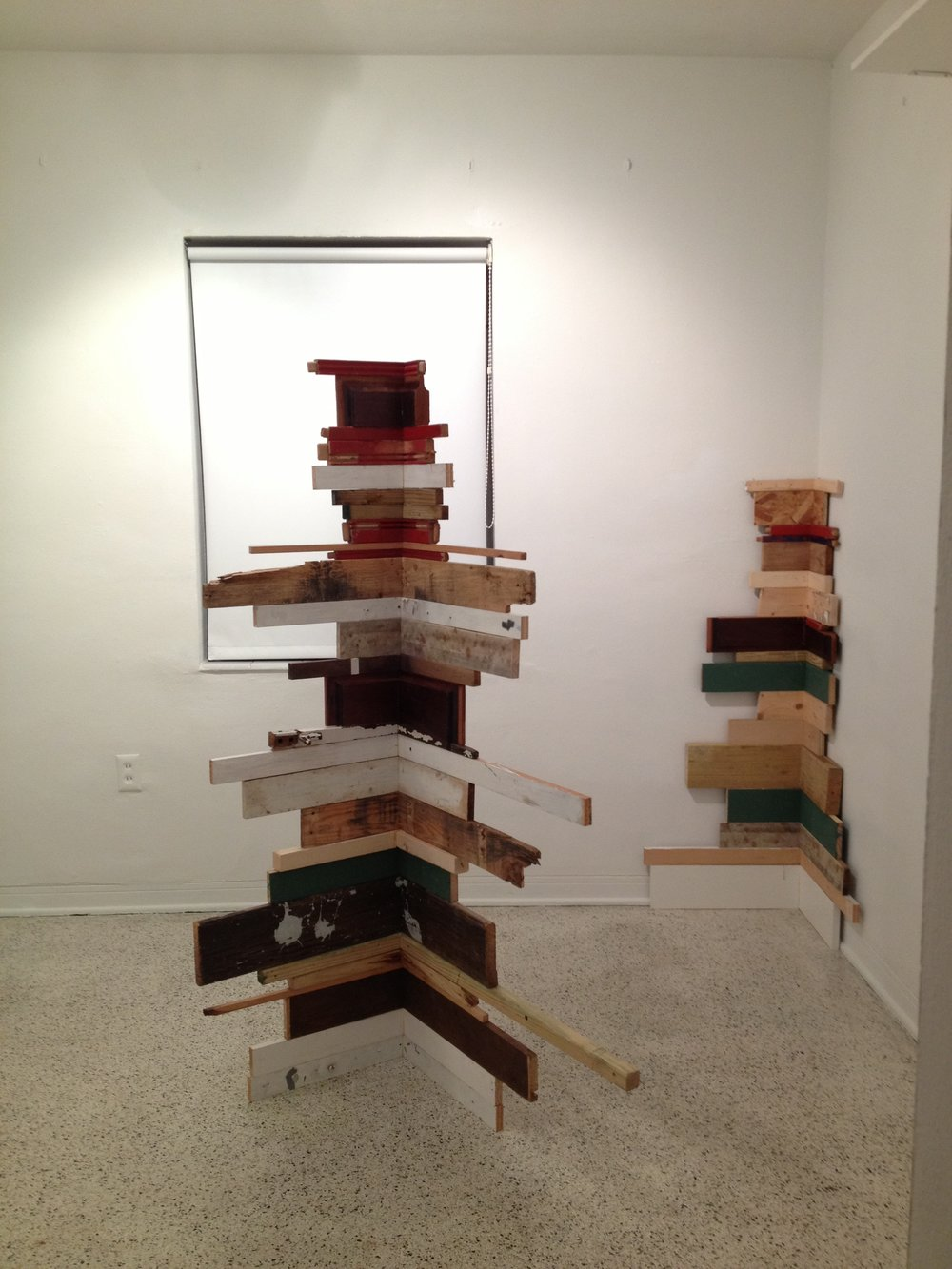 $2000 - Corner wood. Kept wood scraps, balanced & stacked. 60