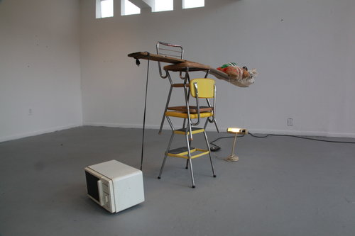 $2500 - The inevitability of love. Found stools, objects bound to found board with string, found microwave, light, frame, extension cord. 8' x 5' x 2'was $4,000
