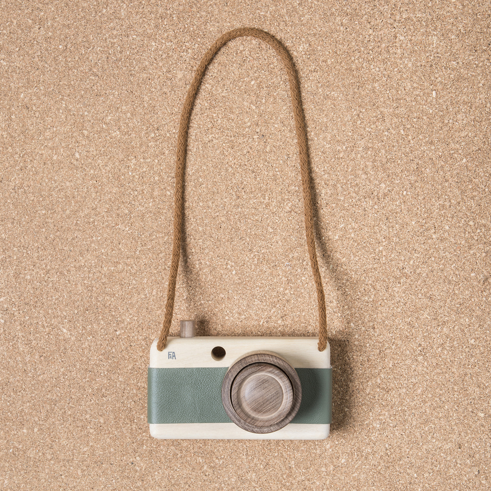 Camera made of Guatambu and Incense wood with leather grip and zoom feature.