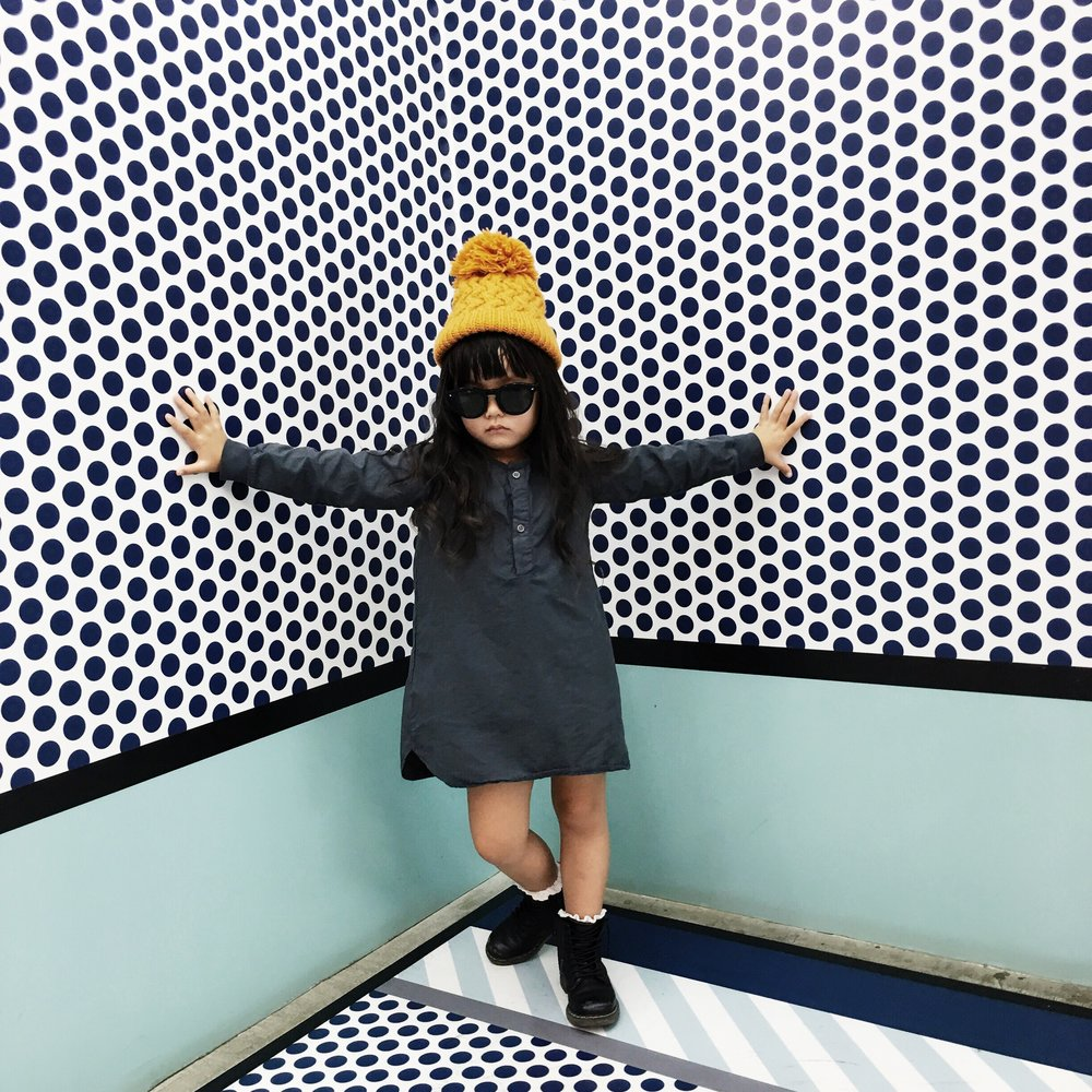 Location: Staircase in Opening Ceremony in Harajuku:Beanie: Velveteen Clothing, Dress: Go Gently Nation, Boots: Dr. Martens