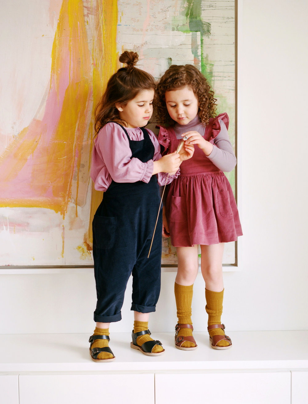 ClaudeOveralls_Navy_MargauxTunic_WildRose_InesPinafore_Rose_ClemenceTurtleneck_Mauve.jpg