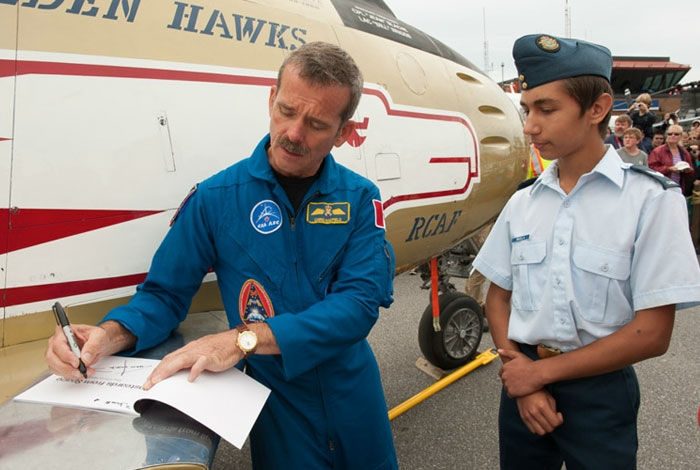 Canadian Astronaut and former Air Cadet, Cmdr. Chris Hadfield signs his autograph.