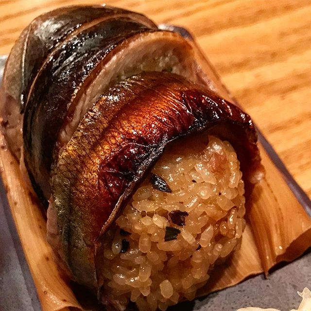 Sanma (Japanese Pike) Onigiri at Sakagura, so good!! Started going here when they opened and it only gets better. Sick sake selection, on point Izakaya fare and in the bowels of an office building, Tokyo style magic!  @sakagurany @sakura_yagi