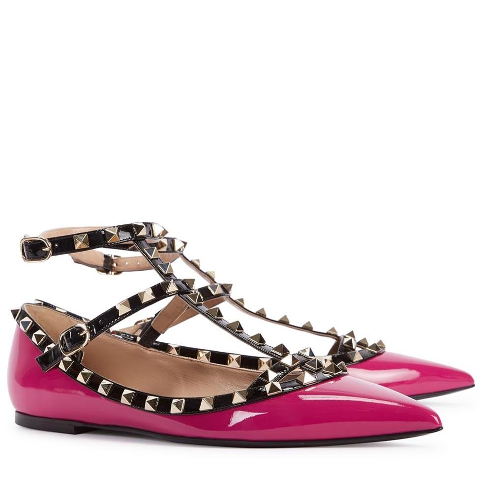 "A signature pair of fuschia purple patent leather ""rockstud"" cageballerina flats from Valentino."