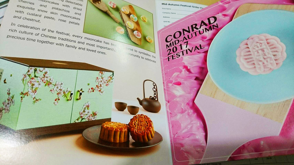 Glossy mooncake brochures from various five-star hotels