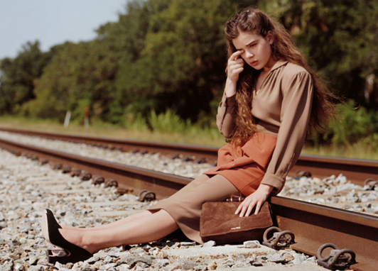 Miu Miu's ad was banned by the UK Advertising Standards Authority for portraying the then 14-year old teen actress sitting on a railway track.