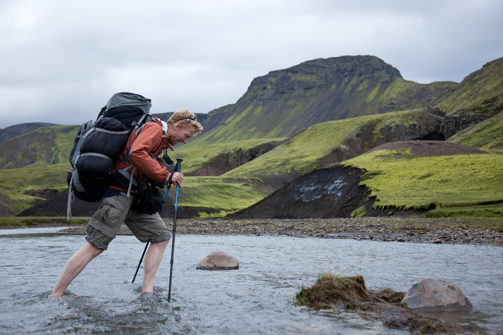 Alastair demonstrating the concept of Type II fun, crossing a freezing stream in Iceland. Read more about Al's trans-Icelandic adventures in our first print issue, on sale late May.