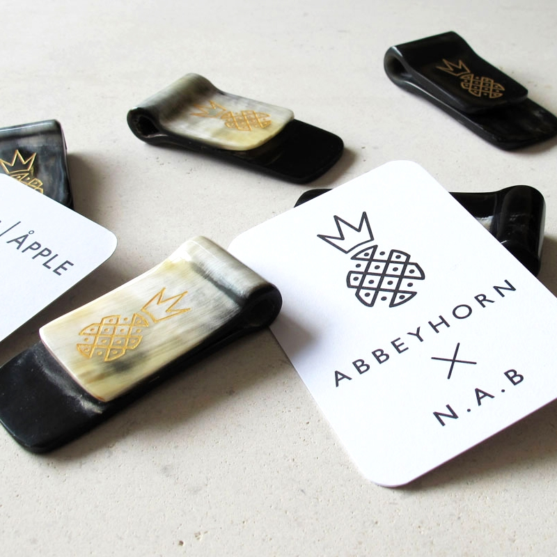 AbbeyHorn Money Clip  An exclusive money clip, engraved with a golden pineapple motif, made from ethically-sourced horn.  £30