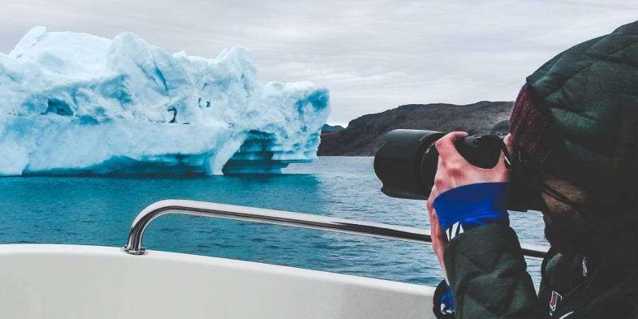 Daniel masters the art of shooting icebergs with cold, numb fingers. Photo: Abi Whyte