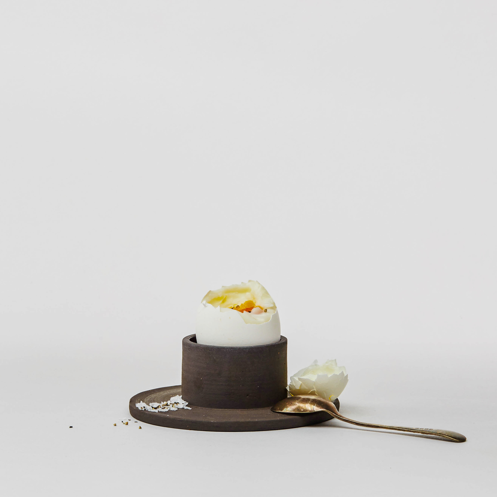 Jono Smart 'Centre' Egg Cup This slate-black egg cup will cradle a large egg beautifully, but its architectural design may steal the breakfast table limelight! £15