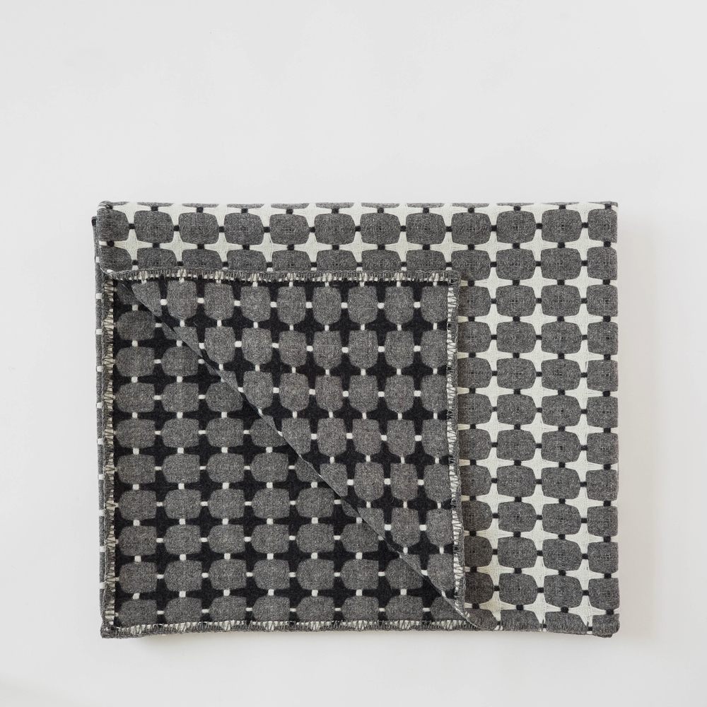 405 Line Blanket A statement piece, not an over statement. The monochrome palette is reversible, woven in 100% wool in Wales. £320